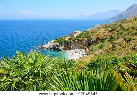 Paradise landscape with beach, sea, mountain, and tropical trees, Italy, Sicily, San Vito Lo Capo. Nature reserve Zingaro.