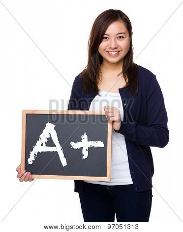 Woman showing the chalkboard with a A plus mark
