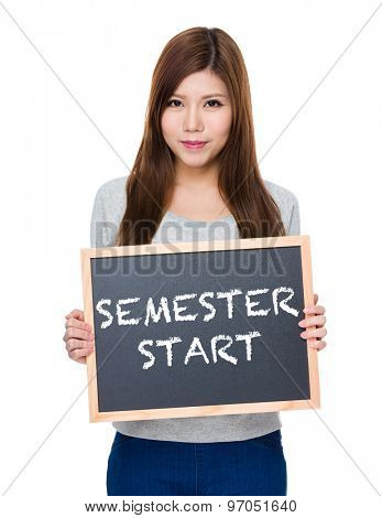 Asian woman hold with blackboard showing phrase of semester start