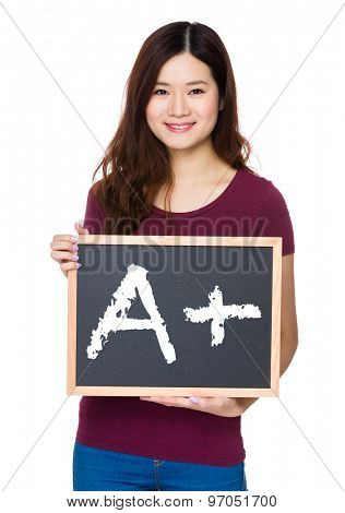 Asian Young woman hold with chalkboard and showing a A plus mark