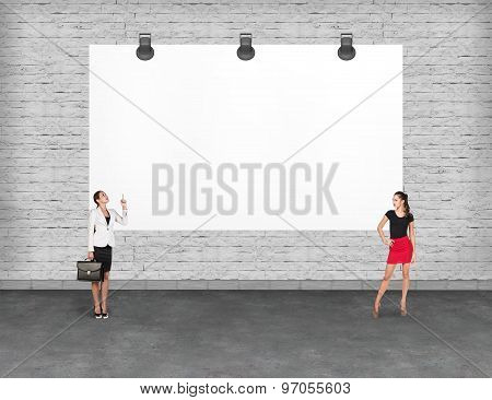 Business person near a blank  billboard