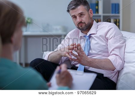 Image of depressed man listening his therapist advice poster