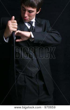 Man Searching His Tux Pockets For Lost Item