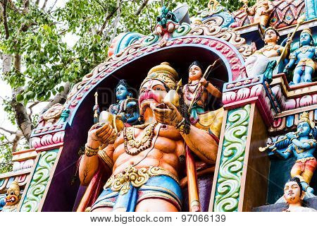 Entrance of a Hindu temple Gopura depicting mythological God Hanuman carrying Lord Ram & Lakshman