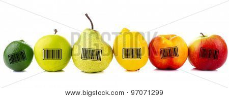 Assortment of juicy fruits with barcodes isolated on white