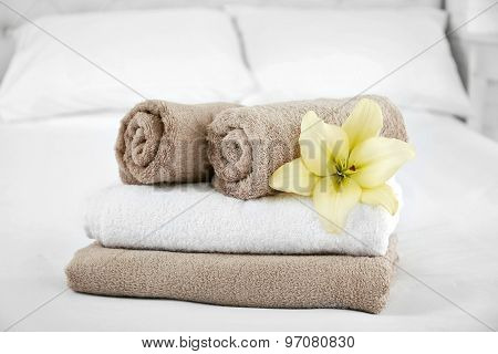 poster of Freshly laundered fluffy towels in bedroom interior