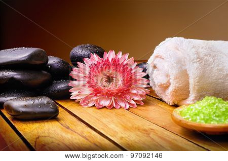 Stones Flower Towel And Bath Salts With Brown Gradient Background