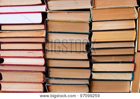 A Stack Of Old Books Compiled In An Upright Position