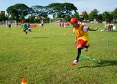 CAN THO VIET NAM- JULY26: Unidentified Asian children playing football summer activity kid physical education trainer training soccer for Vietnamese boy teamwork spirit Vietnam July 26 2015 poster