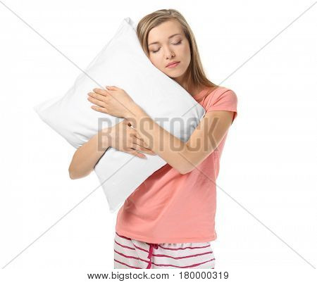 Young sleepy woman with pillow on white background