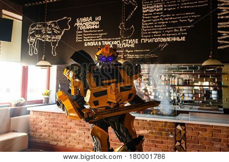 Kaliningrad Russia - March 27 2017: Transformer Bumblebee chooses his own food in the Karamzin restaurant