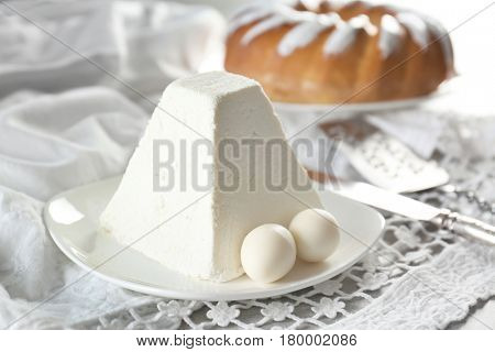 Traditional curd Easter cake on light table