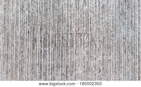 Regular wood texture with vertical lines. Pale grey wooden background for natural banner. Timber texture closeup. Vertical wooden ornament of floor backdrop photo. Natural material for banner template