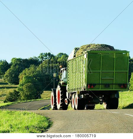Tractor With Trailer Full Of Hay Of Bourgogne Franche Comte
