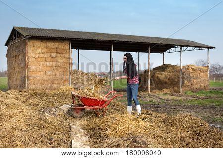 Woman Working Dirty Works On Farm