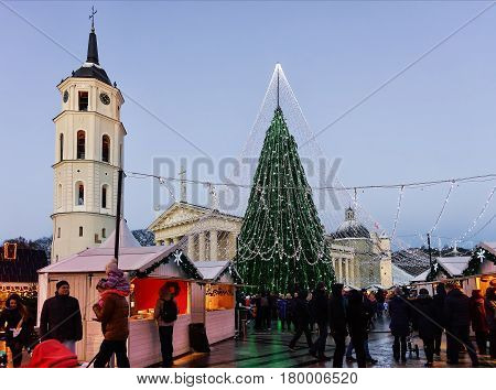 People At Decorated Christmas Tree And Souvenir Xmas Market Of Vilnius