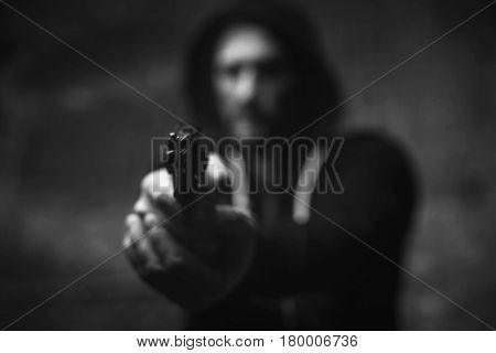 No escape. Raging attacking furious man menacing somebody with a weapon scaring him for getting his money