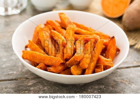 Hearty sweet potato fries served in a bowl.
