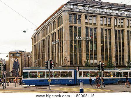 Running Tram On Bahnhofstrasse Street In Zurich City Center