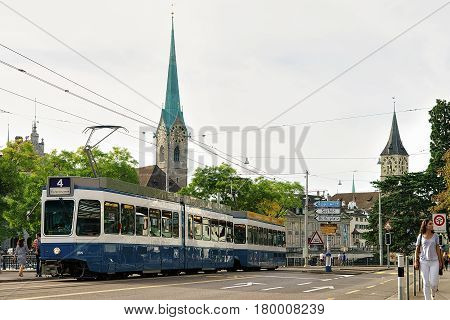 Tram And People At Fraumunster And St Peter Church Zurich