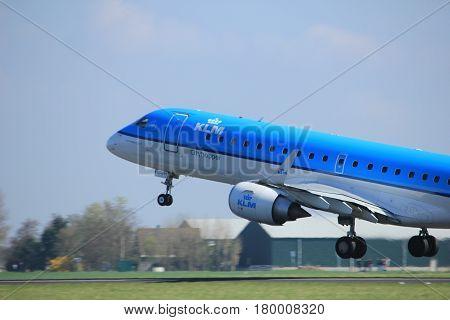 Amsterdam the Netherlands - April 2nd 2017: PH-EXC KLM Cityhopper Embraer ERJ-190STD takeoff from Polderbaan runway Amsterdam Airport Schiphol