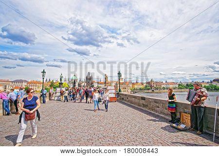 Crowds Of Tourists On Charles Bridge Over Vltava River Prague