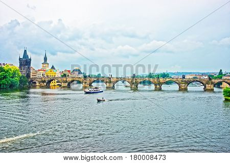 Ferry And Boat At Charles Bridge In Prague