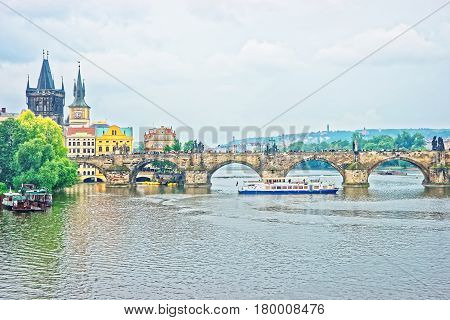 Ferry At Charles Bridge In Prague