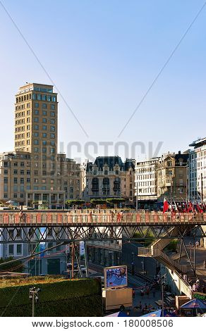 Lausanne Switzerland - August 26 2016: Le Flon district with Grand pont bridge and Bel Air Tower in Lausanne in Switzerland. People on the background