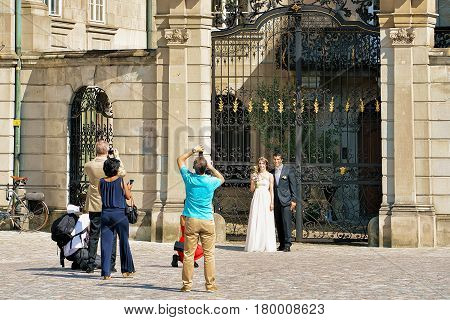Just Married Couple Being Photographed In Streets In Zurich