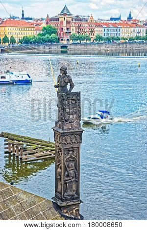 Knight Statue On Charles Bridge Over Vltava River In Prague