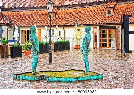 Peeing Statues In Kafka Museum In Prague