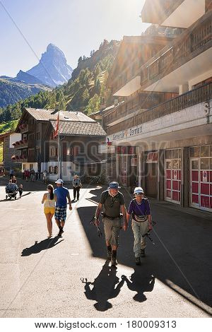 Senior Tourists In Zermatt With View On Matterhorn Top