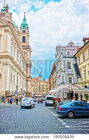 Street With People At St Nicholas Church In Prague