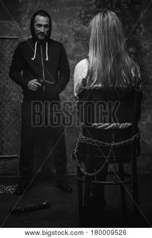 So let us have a talk. Dangerous dreaded vicious criminal staring at his victim and smiling while feeling power over her