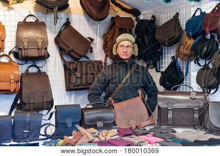 Man Selling Handmade Leather Bags At Vilnius Christmas Market Advent