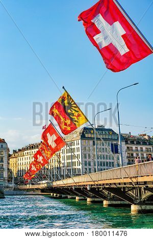 Mont Blanc Bridge And Swiss Flags Above Geneva Lake Geneva