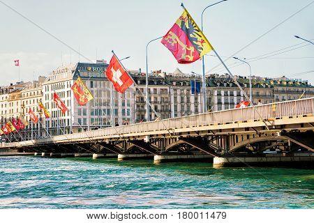 Mont Blanc Bridge And Swiss Flags Over Geneva Lake Geneva