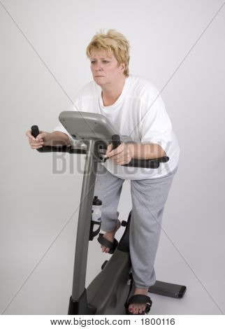 Woman On Excercise Bike