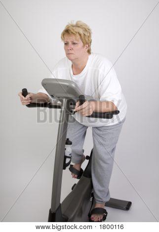 Woman On Excercise Bike