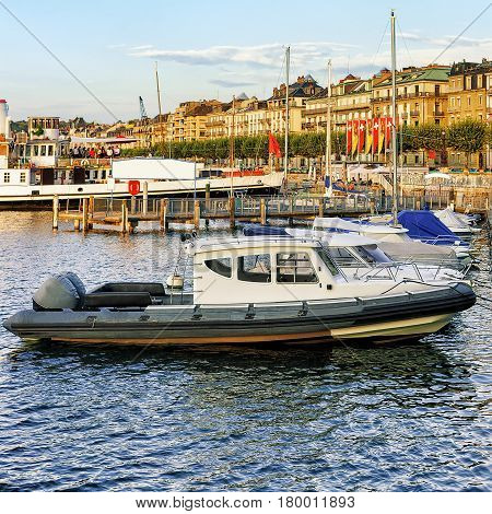 Boat At Geneva Lake Near Embankment Of Promenade Du Lac
