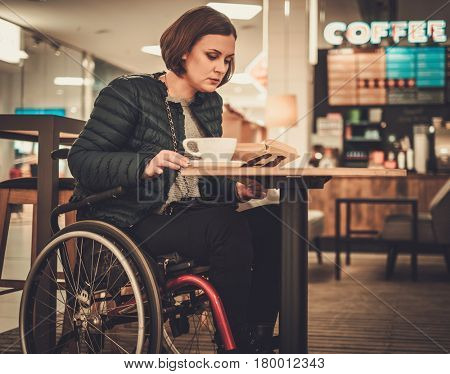Physically challenged women in a cafe