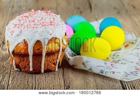 Baking home made Easter bread with organic Easter cake and colored eggseggs.