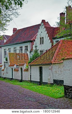 Benedictine Beguinage In Medieval Old City In Bruges
