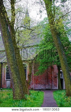 Benedictine Beguinage In Medieval Old Town Of Bruges