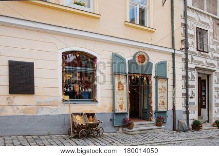 Street With Cafe In Old City Of Cesky Krumlov