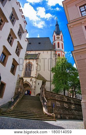 Street With Stairs And Saint Vitus Church Cesky Krumlov