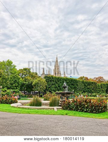 Volksgarten or People Garden of Hofburg Palace in Vienna Austria. Tourists on the background