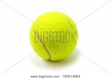 Yellow tennis ball on white background. Isolated tennis ball. Yellow fluffy ball with brown curve line and small shadow. Tennis game equipment. Sport and active lifestyle symbol. Summer outdoor game