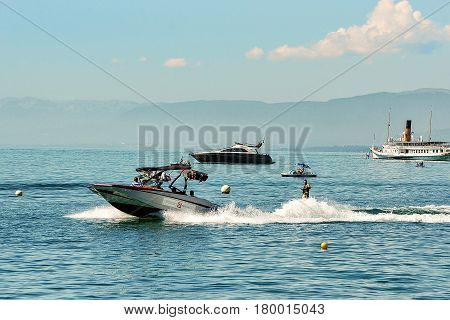 Lausanne Switzerland - August 26 2016: Motor boat and man wakeboarding in Lake Geneva in Lausanne Switzerland